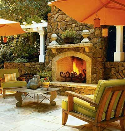 like:  furniture, umbrellas, fireplace grate, and decor on the mantel