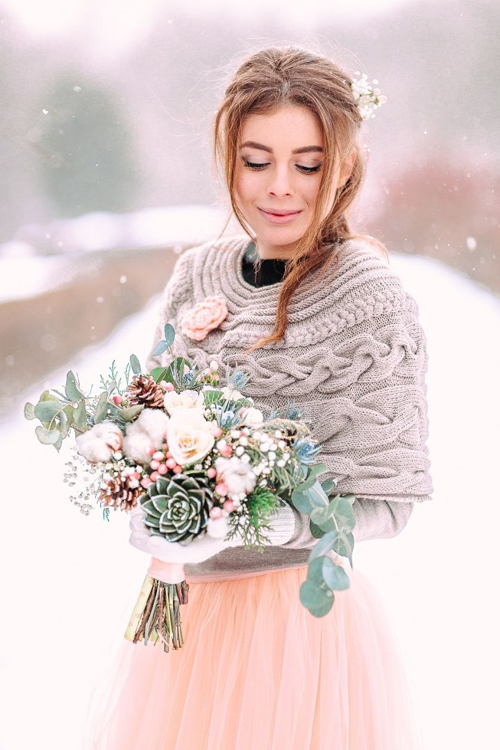 Peach wedding dress and grey knitwear cardigan + peach winter wedding bouquet | fabmood.com #wedding #winterwedding #outdoorwedding #snow #bride #weddingdress #peach