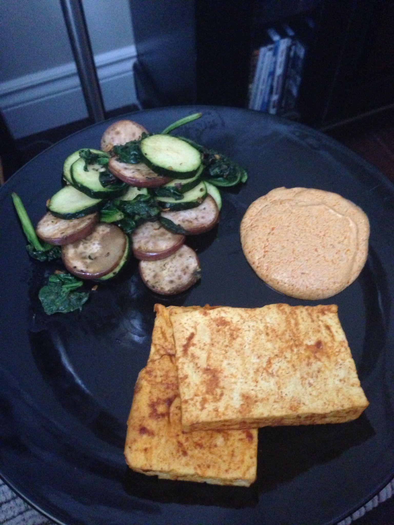 Grilled tandoori tofu  http://mobile.eatingwell.com/recipes/tandoori_tofu.html