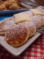 The Dutch Table: Poffertjes. Yum. Def use butter in the pan, not oil. And make sure the pan is really quite hot. They'll turn out perfectly fluffy that way.