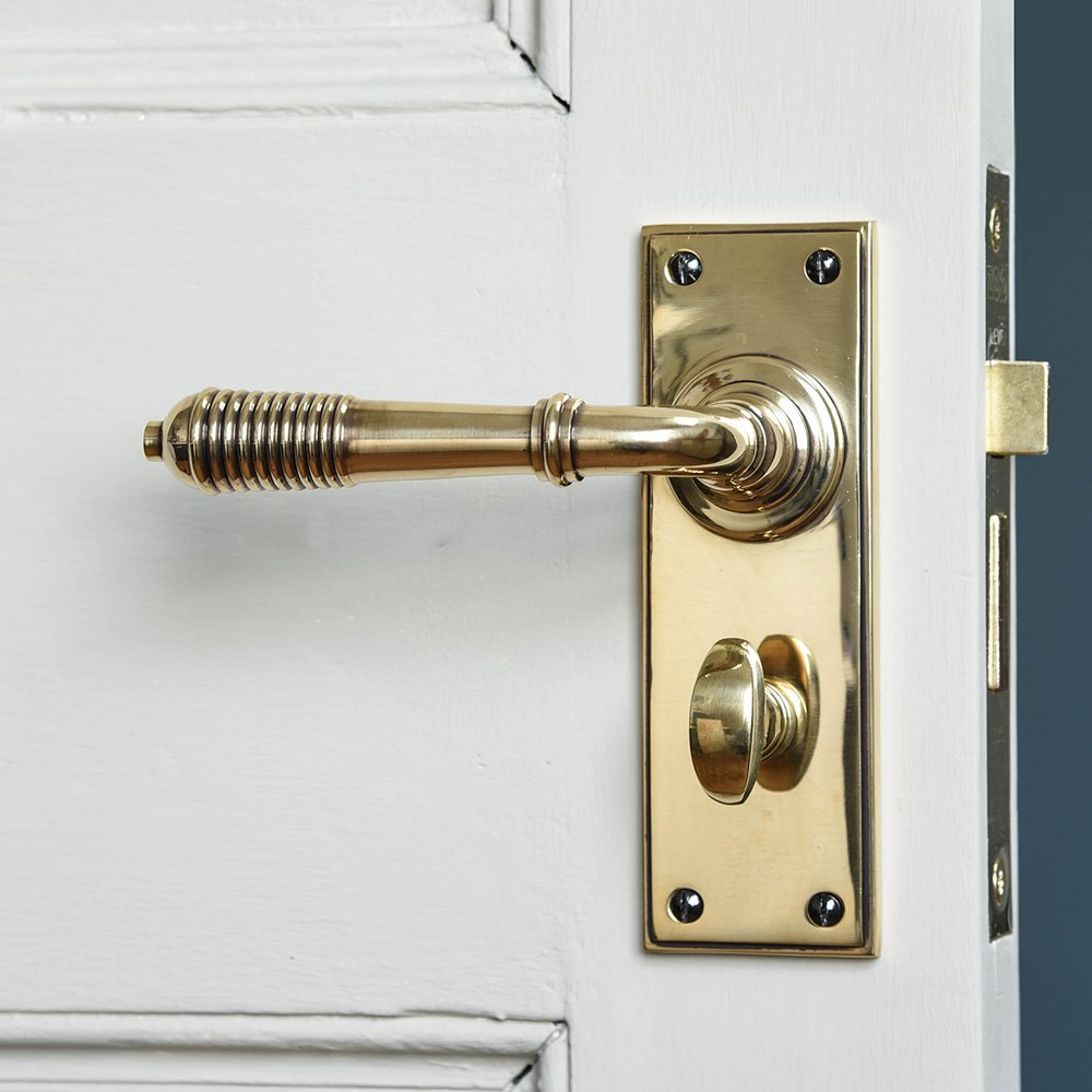 Reeded Lever Handle With Bathroom Lock Aged Brass In 2020