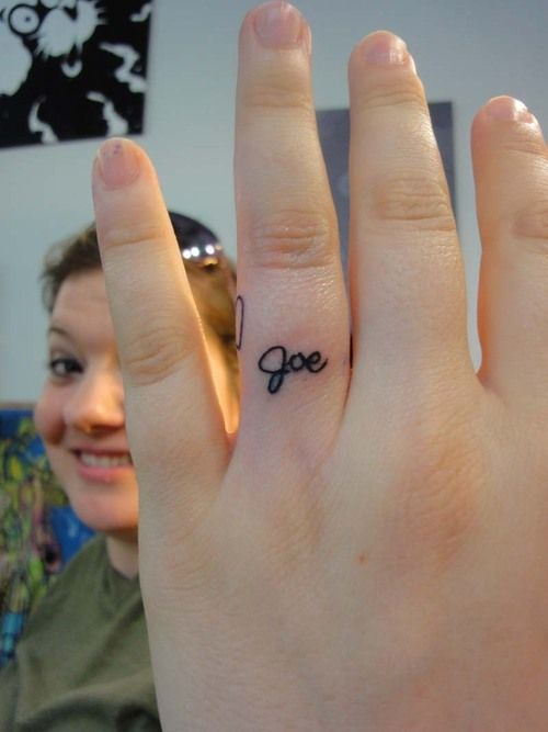 White Wedding Ring Tattoos: Wedding Ring Tattoo Of His Name In White Ink