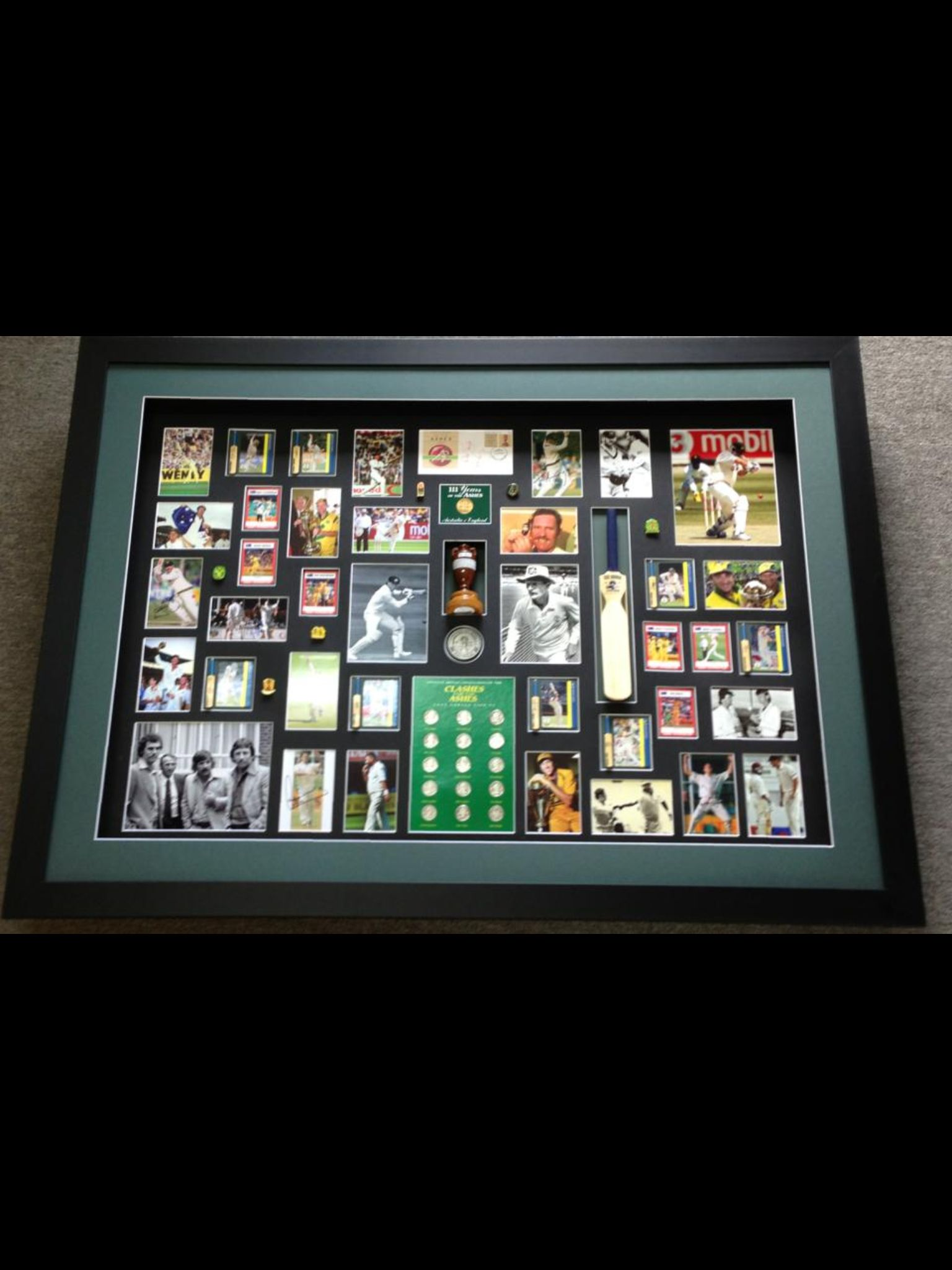 This is a job we did for a client  He brought a box in and asked us to design and layout how we thought its 3d boxed framed, triple matted all with acid free products (Framing Alternative)