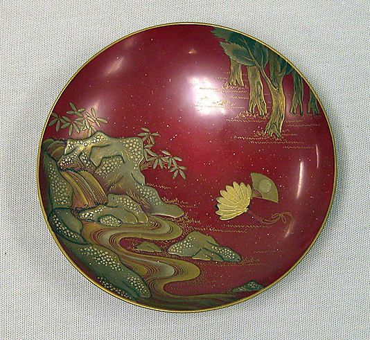 Sake Cup Shomosai (Japanese, active late 18th–early 19th century) Period: Edo period (1615–1868) Date: mid-19th century Culture: Japan Medium: Gold lacquer on red lacquer ground Dimensions: H. 1 in. (2.5 cm); W. 4 1/8 in. (10.5 cm) Classification: Lacquer