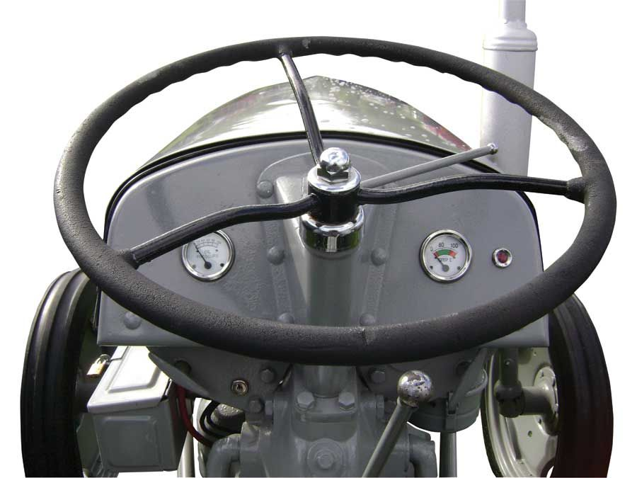 A Ferguson tractor with a standard engine. Note the shorter dashboard and lower…