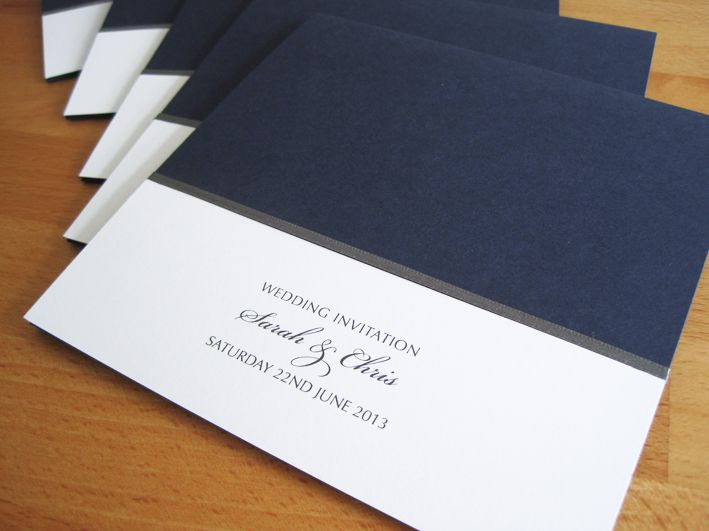 Manhattan as a pocketfold invitation in navy and white and finished with grey ribbon.