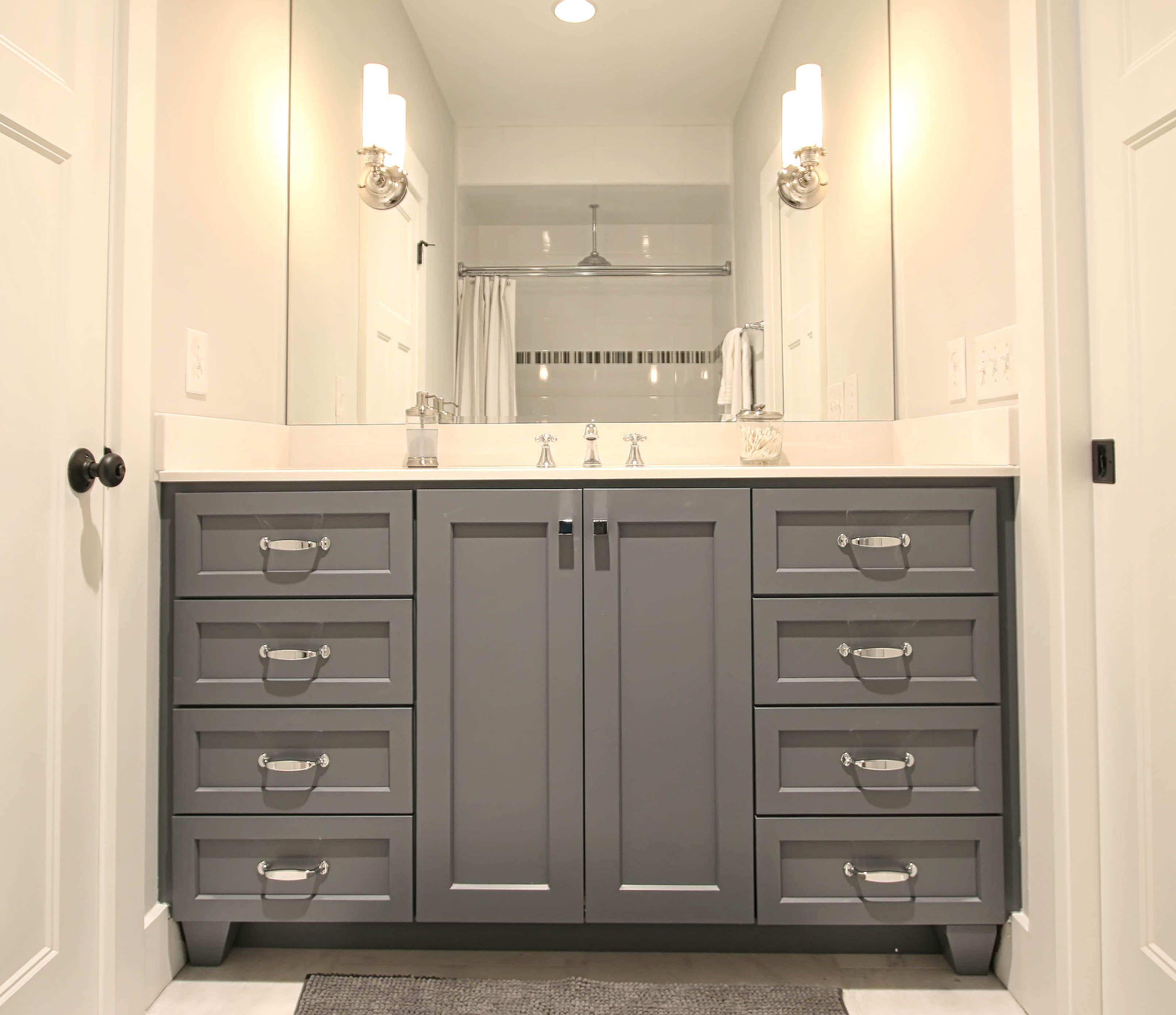 Bathroom, small bathroom, Jack and Jill bathroom, Walker Woodworking custom  cabinets, sconce