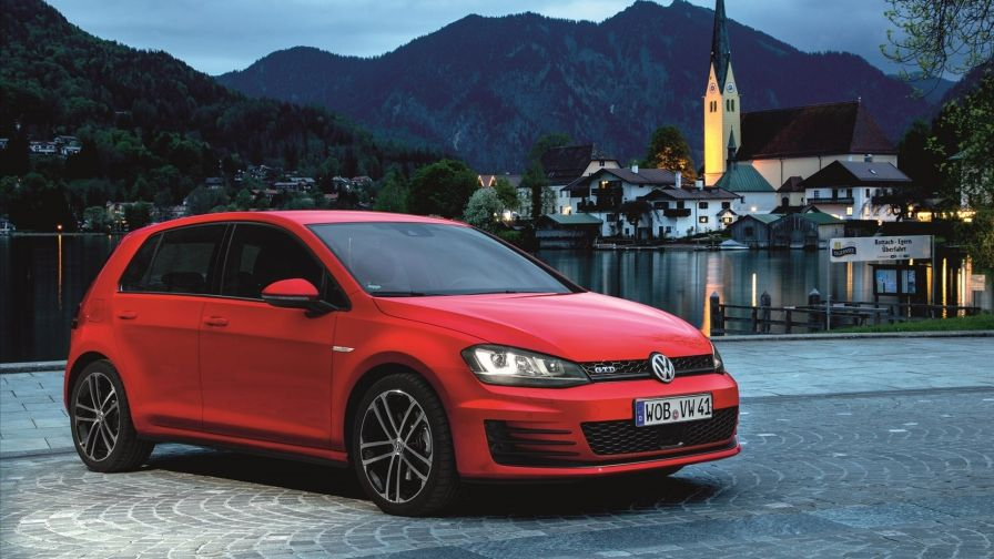 Free Wallpaper With Red Volkswagen Golf Gtd In The Background An Old German Town Located On The Lake Between The Mountains Volkswagen Golf Volkswagen Vw Golf
