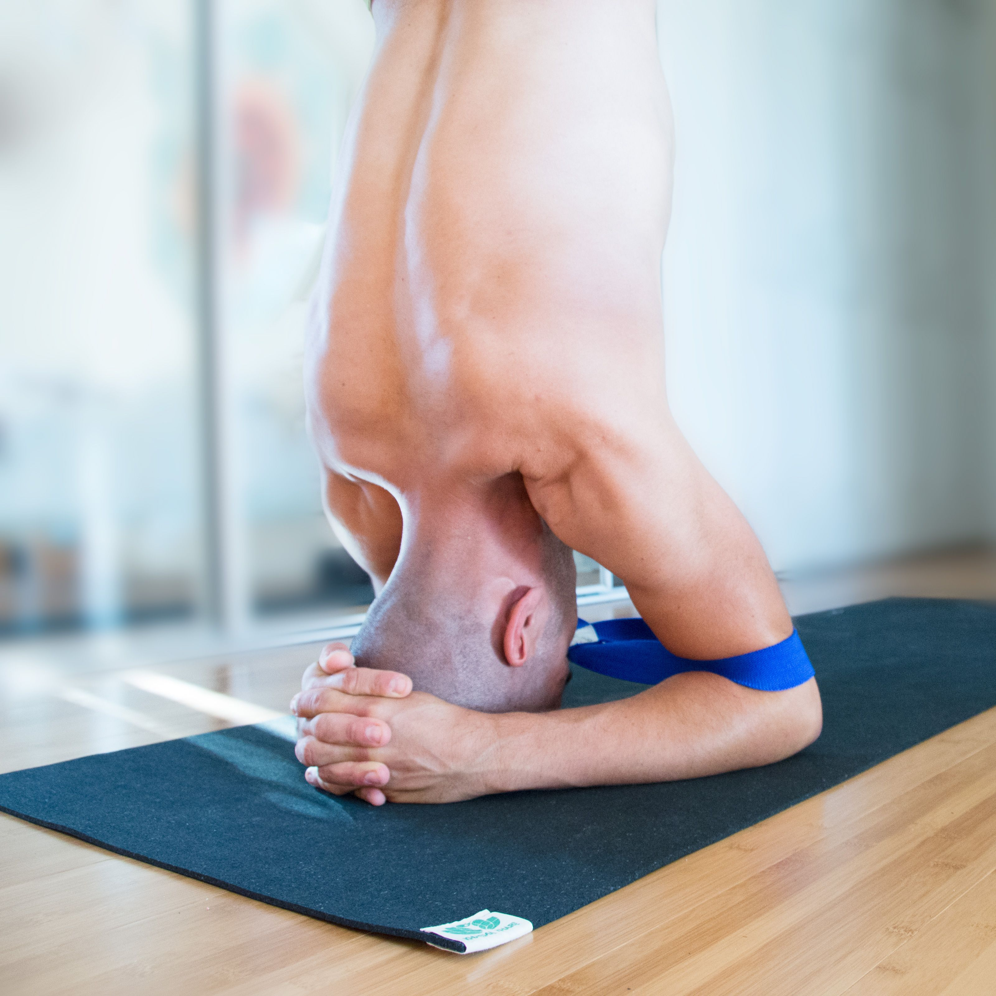 Sirsasana (Supported Headstand) with our Moonbeam Stretch Strap.