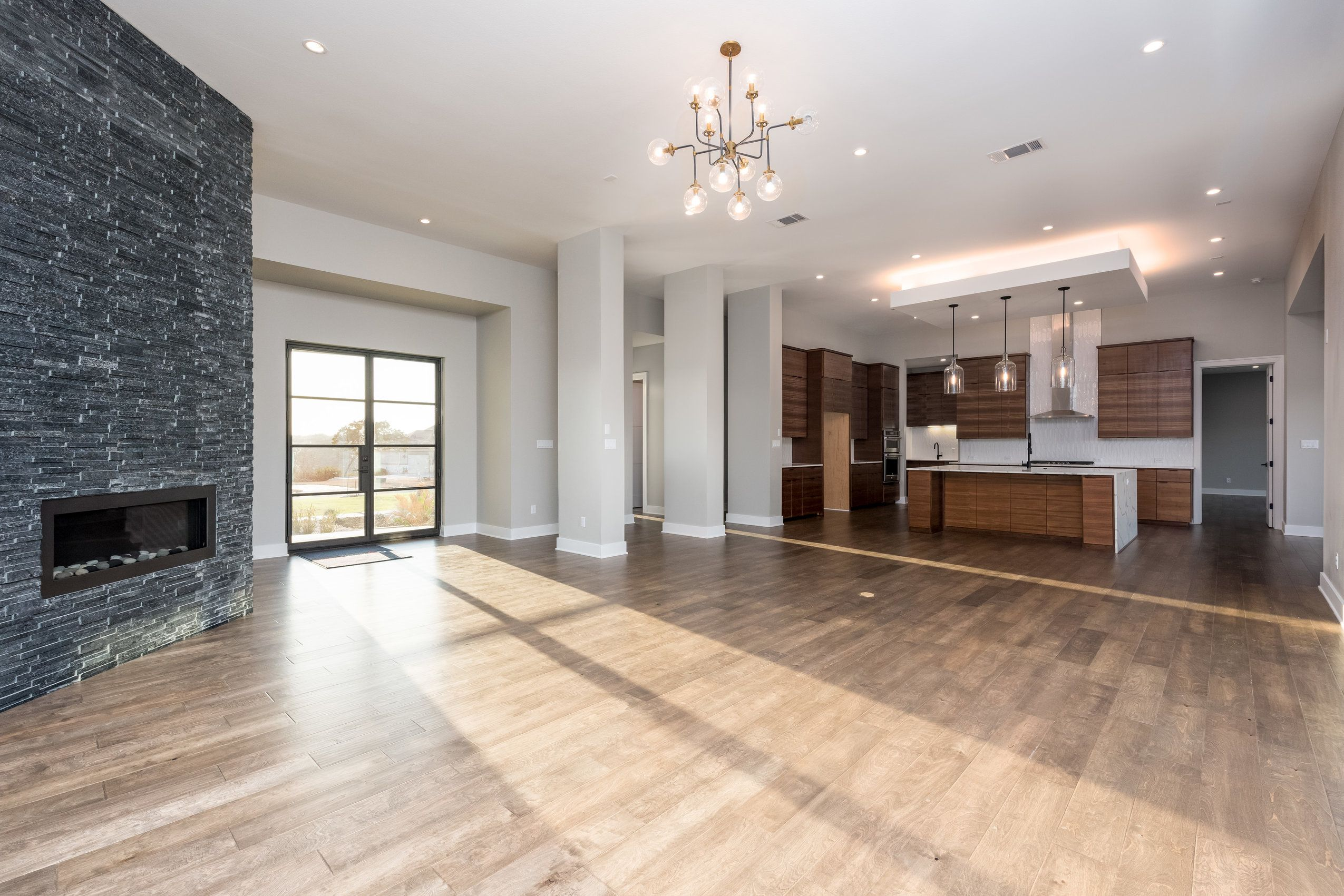 You Ll Swoon For The Wide Open Entertainer S Floor Plan That Seamlessly Connects The Living Custom Home Builders Modern Family Rooms Modern Farmhouse Exterior