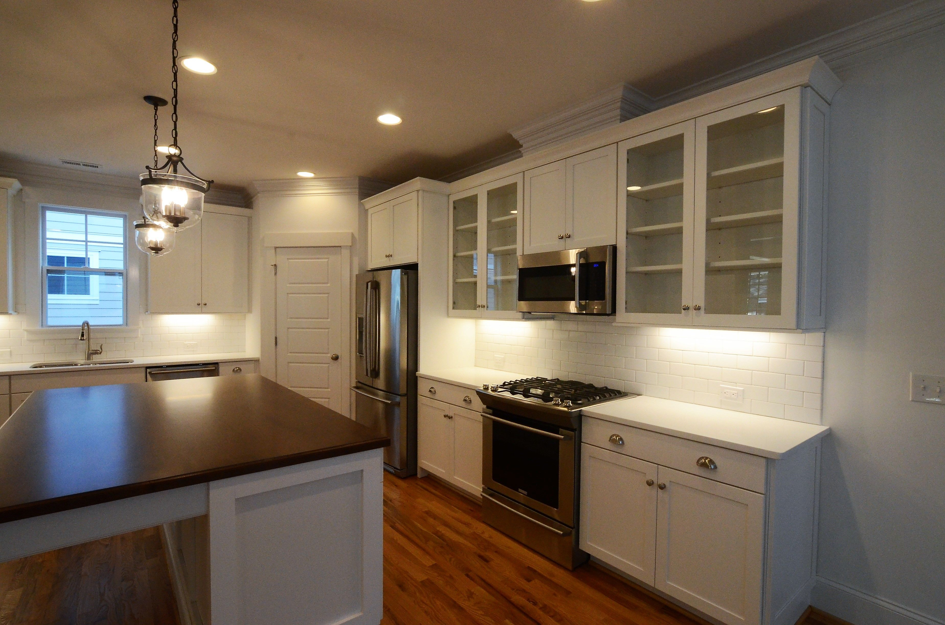White cabinets, Maple wood top on Island, Natural finish ... on Natural Maple Cabinets With Quartz Countertops  id=28341