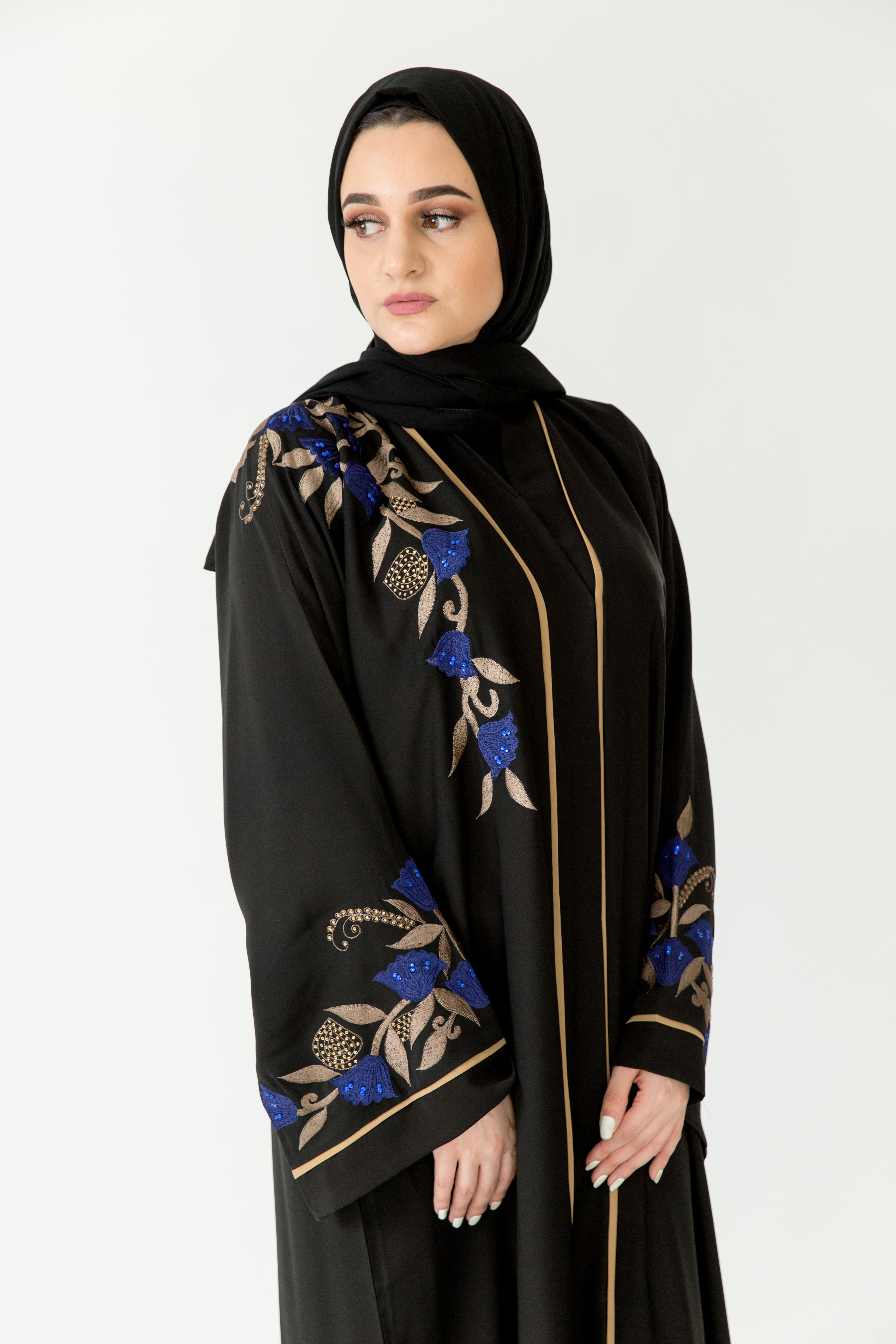 Drawing The Eyes With Its Exquisite Blue And Gold Embroidery Our Layali Abaya Is Just The Thing For An Evening Soir Abayas Fashion Abaya Designs Abaya Fashion