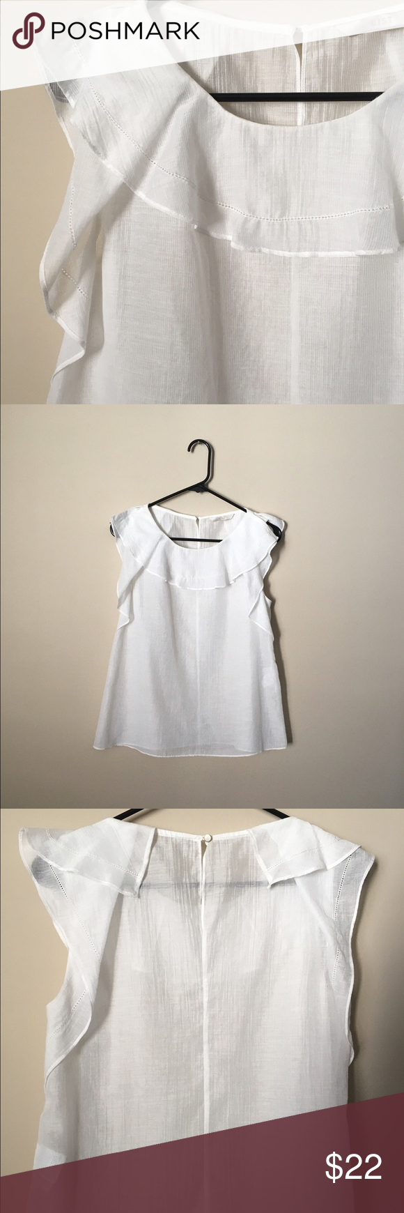 White blouse Beautiful white flowing blouse. A soft linen material. No size tag but I would recommend for a small or medium Tops Blouses