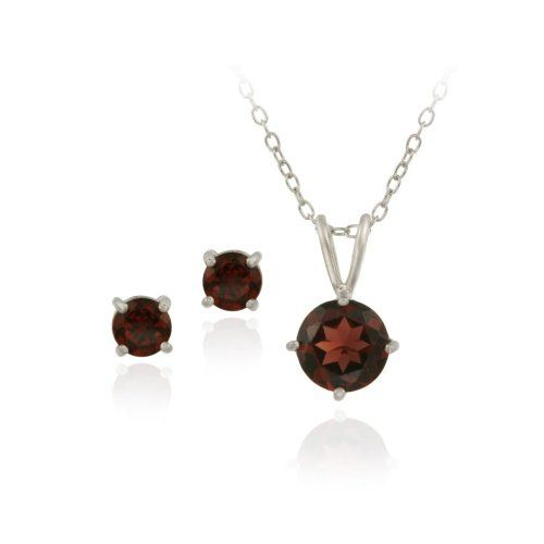 "$14.99 This classic jewelry set features a round solitaire pendant and matching round stud earrings. The pendant showcases a sparkling 7mm garnet stone, and the earrings feature two 5mm garnet stones. The jewelry is crafted of solid sterling silver with high-quality rhodium plating, for maximum shine and tarnish protection. Pendant dangles from an 18"" chain. Total gem weight: 2.95ct."