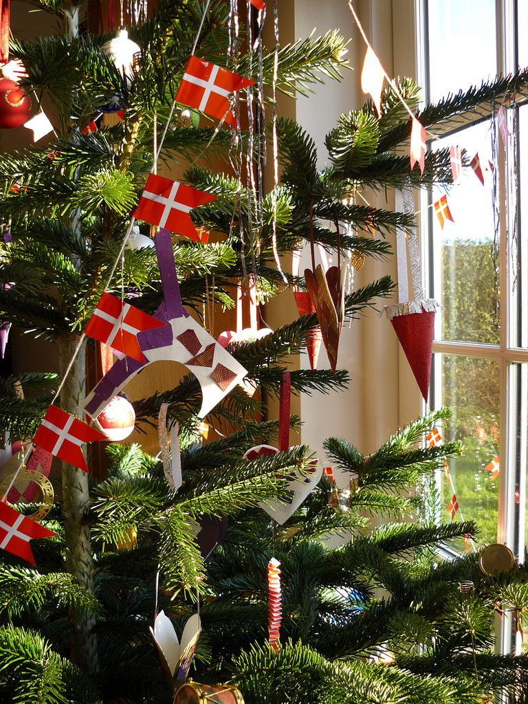 garlands of danish flags are a traditional decorations on danish christmas trees danes traditionally light the christmas tree with real candlesand a fire