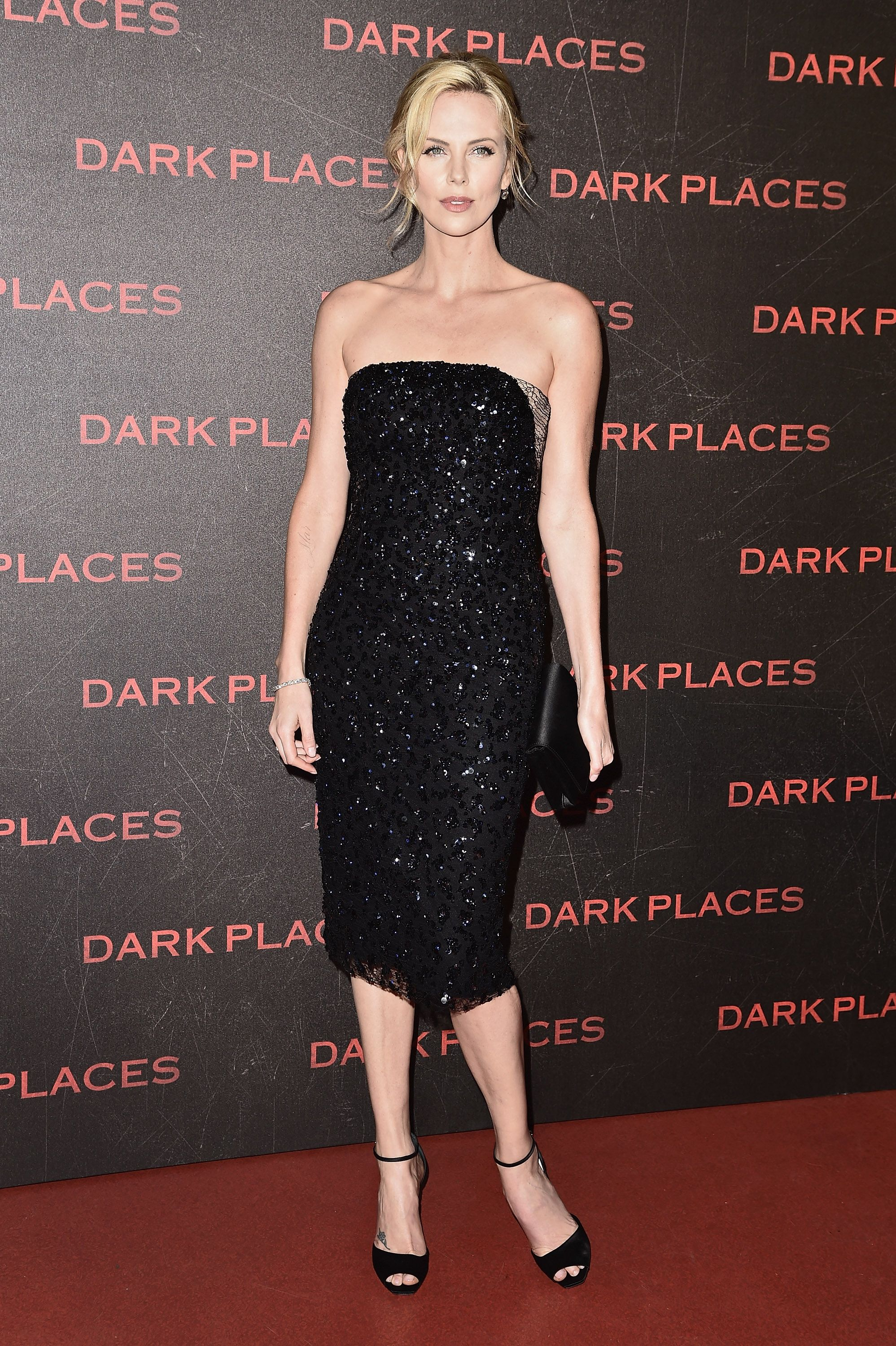 Black dress with touch of red -  Thelist Best Dressed Just A Touch Charlize Theronred Carpet Dressesamazing