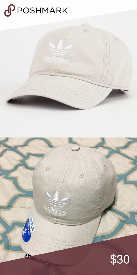 1e6268050dd Adidas Originals Relaxed Dad Baseball Hat ✨Color  Khaki   White ❤️Features  an embroidered Adidas Trefoil logo on the front panel and at the back.
