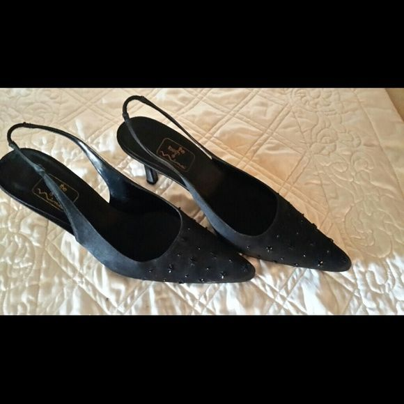 Shoes Black dressy sling back pumps.  Front of shoe has black embellished beads for a touch of elegance.   Has a 3 inch heel...worn twice for a wedding.  Some wear on bottom of shoe that's to be expected but isn't noticeable from top of shoe. In very good condition. ....great for an evening out... a touch of nina Shoes