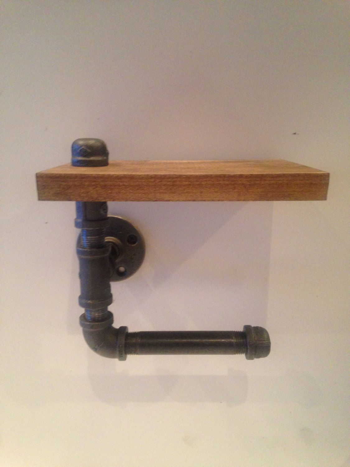 A personal favorite from my Etsy shop https://www.etsy.com/listing/270106517/industrial-pipe-toilet-paper-holder