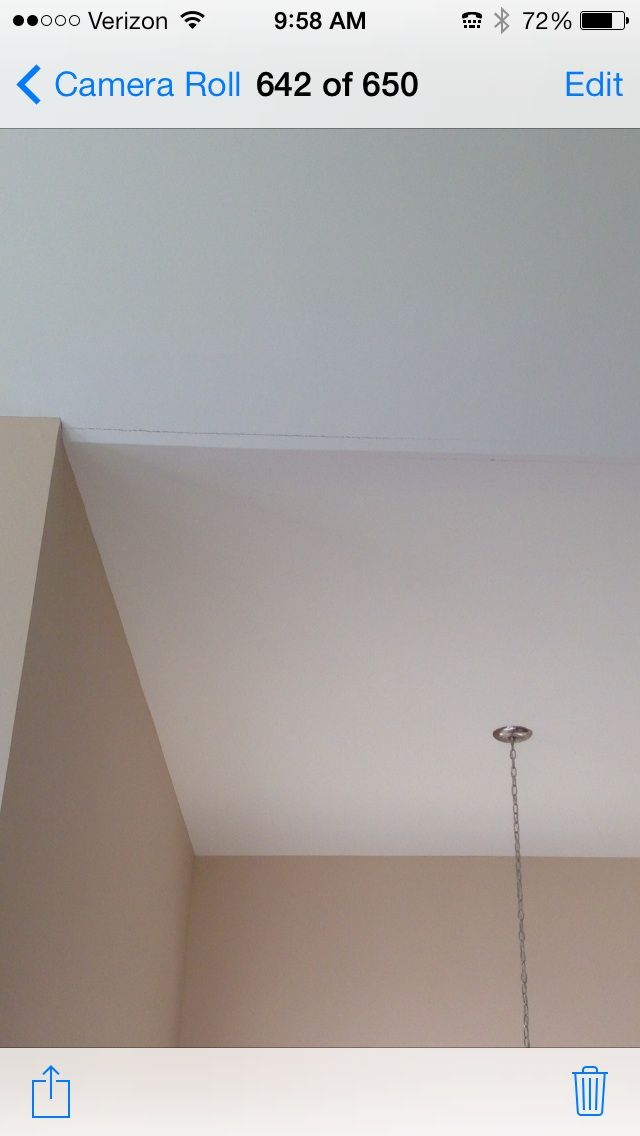 what causes drywall crack at ceiling tape joint entire length of