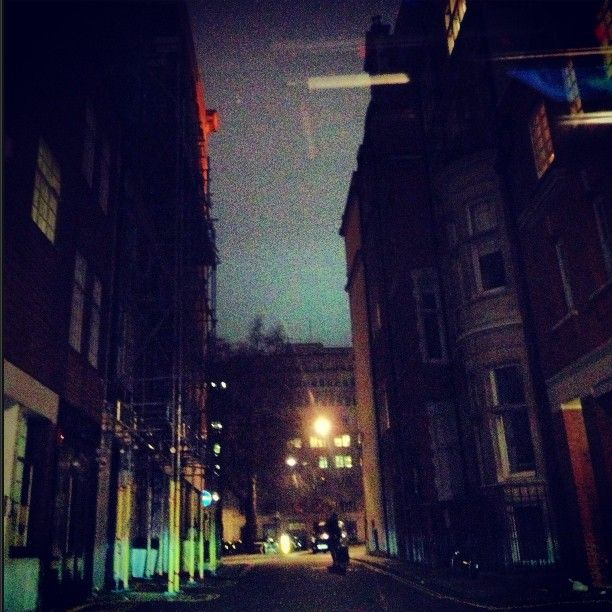 White sky at night in Mayfair. Why does it remind me so much of the famous David Bowie album cover The Rise and Fall of Ziggy Stardust and the Spiders from Mars? That picture by Brian Ward and hand coloured by Terry Pastor was taken in Heddon street which happens also to be in Mayfair . A propos de rien , above Bowie's head in the picture hangs a sign with the name K. West written on it. That album cover was ahead of its time. #davidbowie #ziggystardust #kanyewest. 6th January 2013