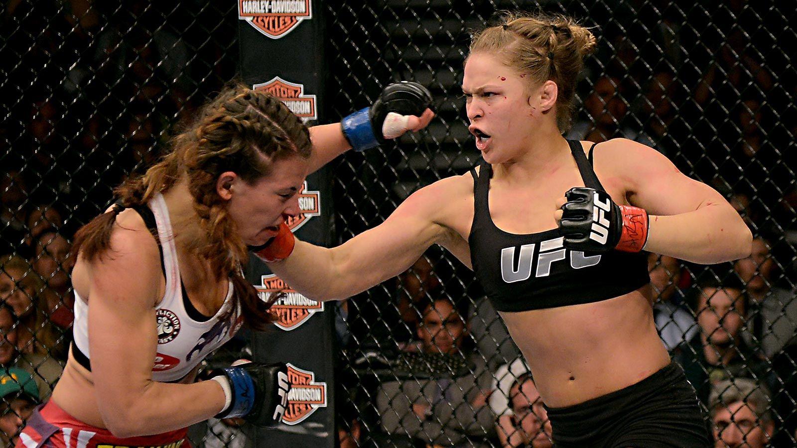 122813 Ufc Ronda Rousey Punches Miesha Tate Ahn Pi Jpg 1600 900 Ronda Rousey Ronda Rousey Ufc Miesha Tate