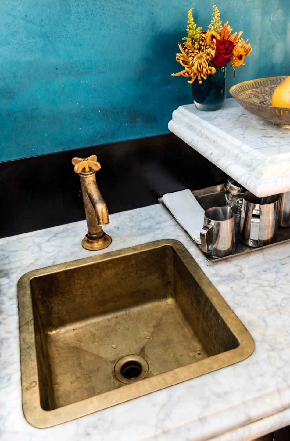 the alexander marchant handmade waterloo bar sink in unlacquered brass finish installed with the waterworks