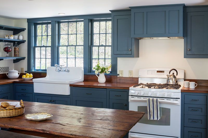 The Kitchen Was Updated With Custom Painted Cabinets, Open Shelving And A  Porcelain Sink With