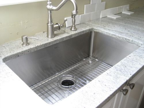 kraus sink 32 inch stainless steel undercount  tight radius  square with slightly rounded corners   u0026 rinse guard  another shot of the kraus stainless steel kitchen sink  looks      rh   pinterest com