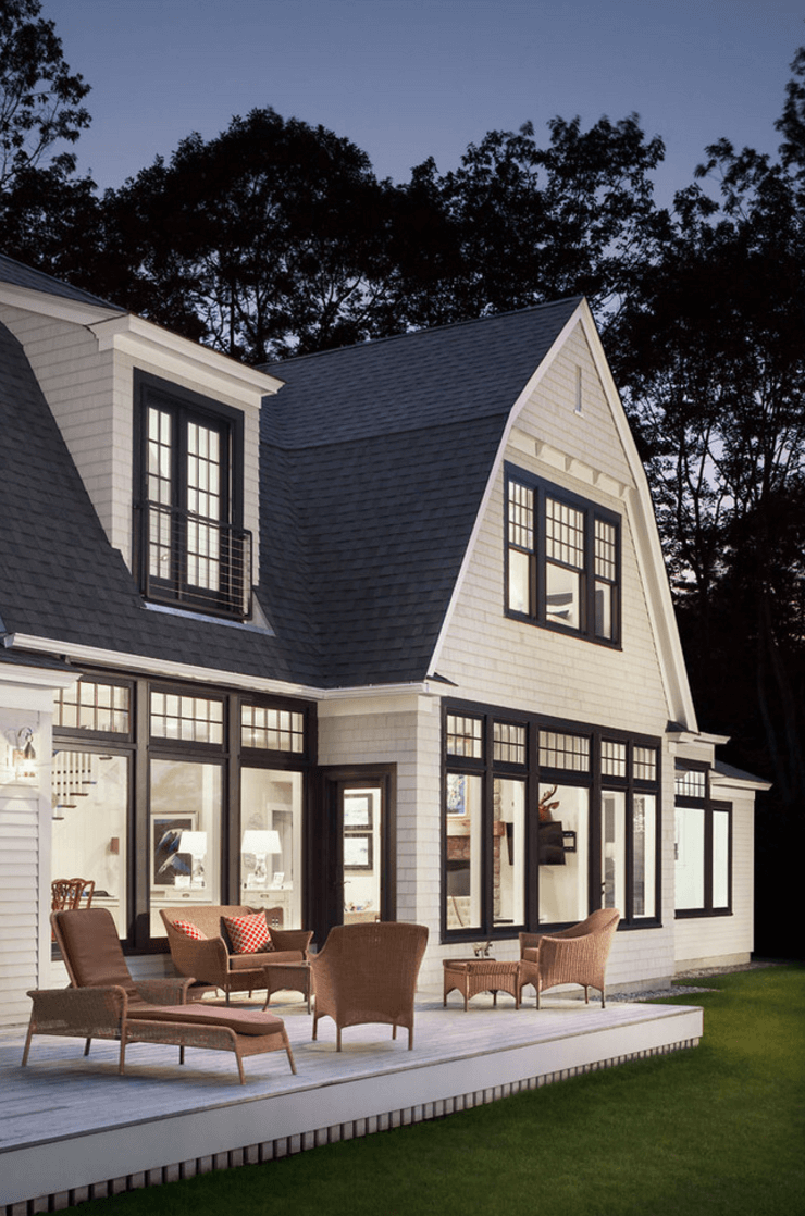 Black exterior trim black window trim exterior beach style with picture window beige siding wicker outdoor armchair shiny garage jet black exterior trim