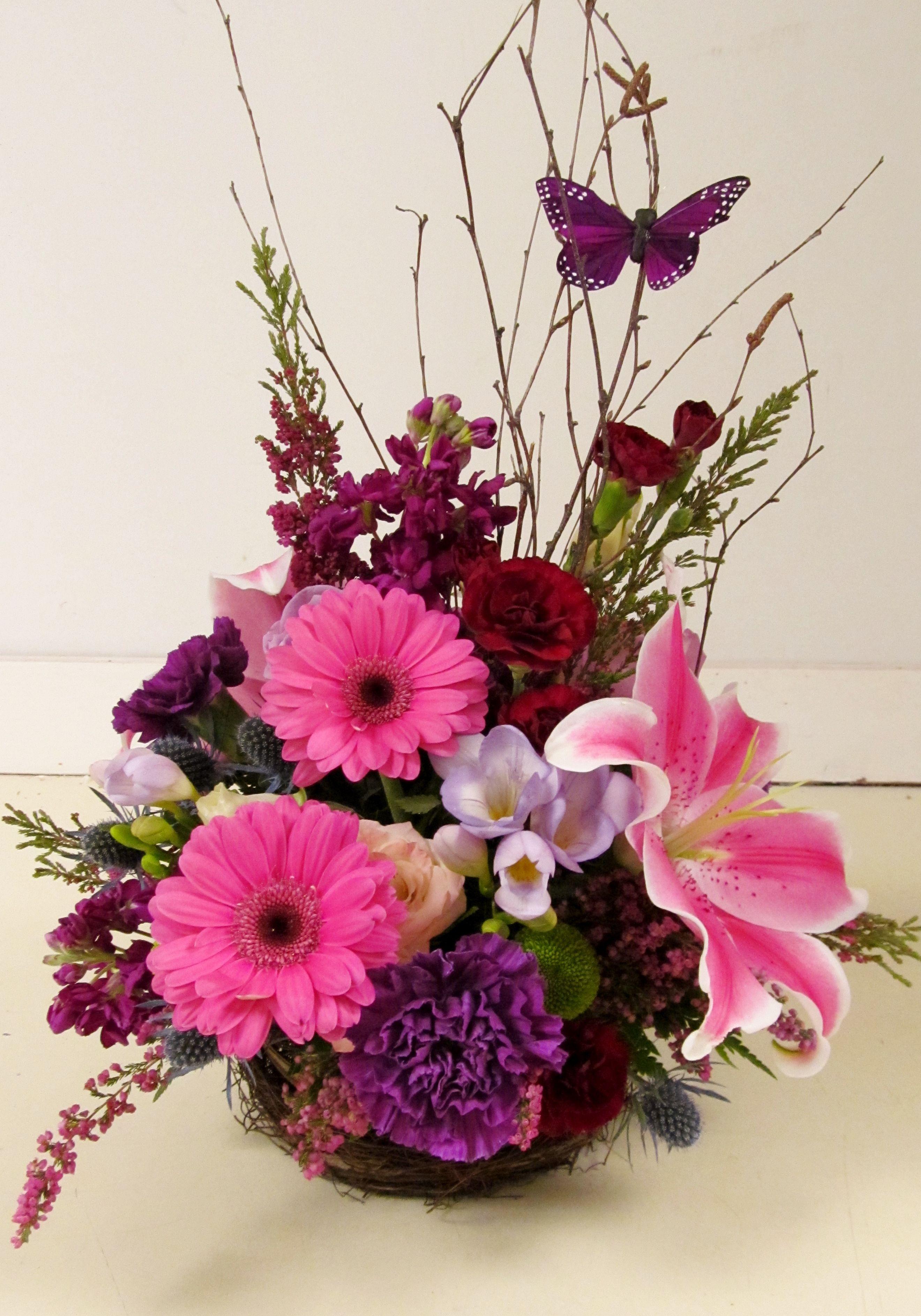 Bright Floral Arrangement With A Springtime Butterfly Floral Floral Arrangements Flower Arrangements