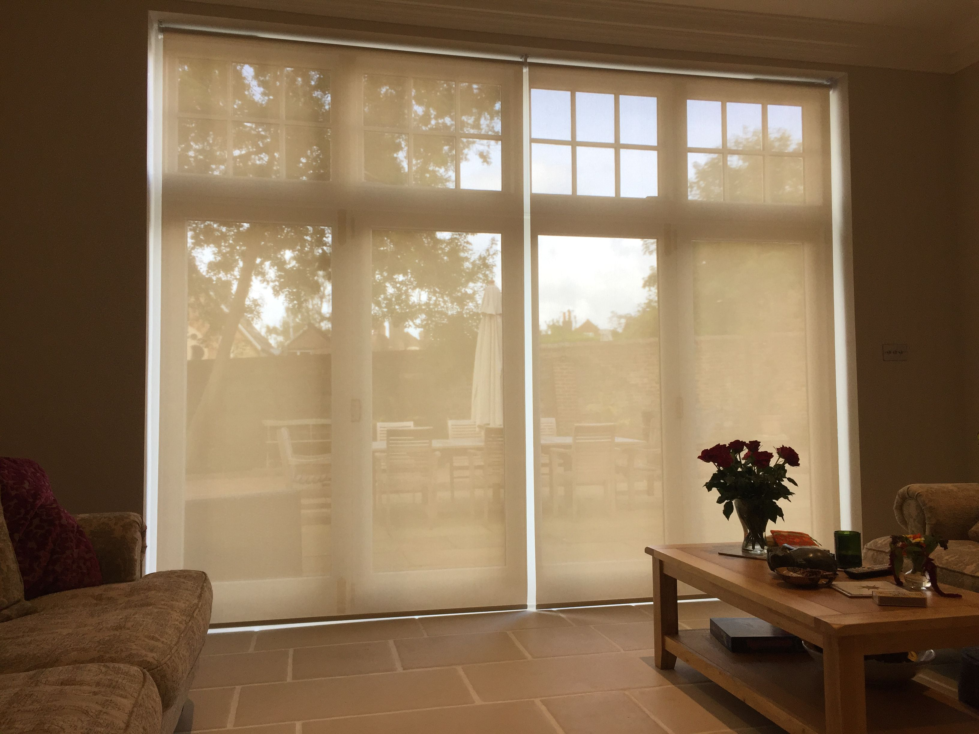 Sunscreen Roller Blinds Fitted To French Doors In Living