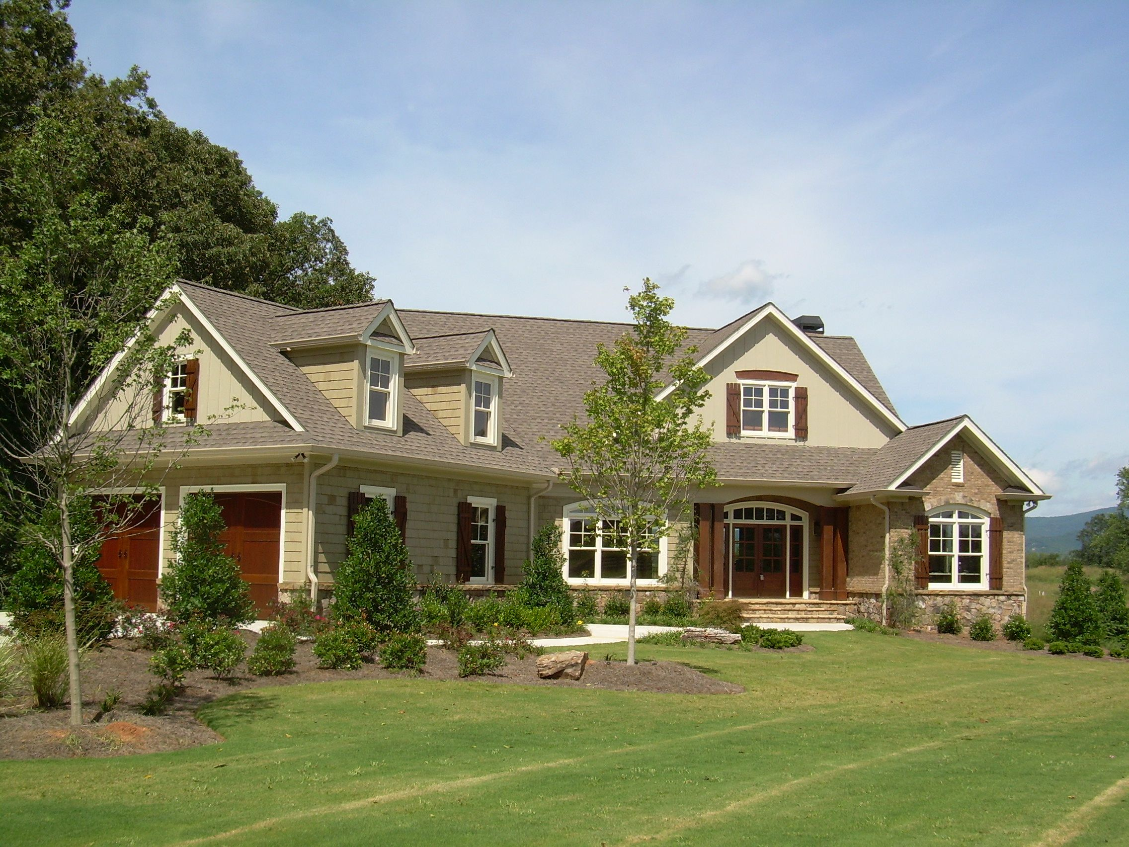 House With Stone Accent Front And Side Entry Garage House Front House Exterior Exterior House Colors