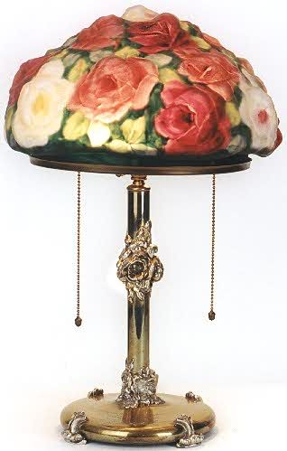 """A Pairpoint """"puffy"""" lamp. Blown out decorated glass made these colorful and now very collectible lamps unique."""