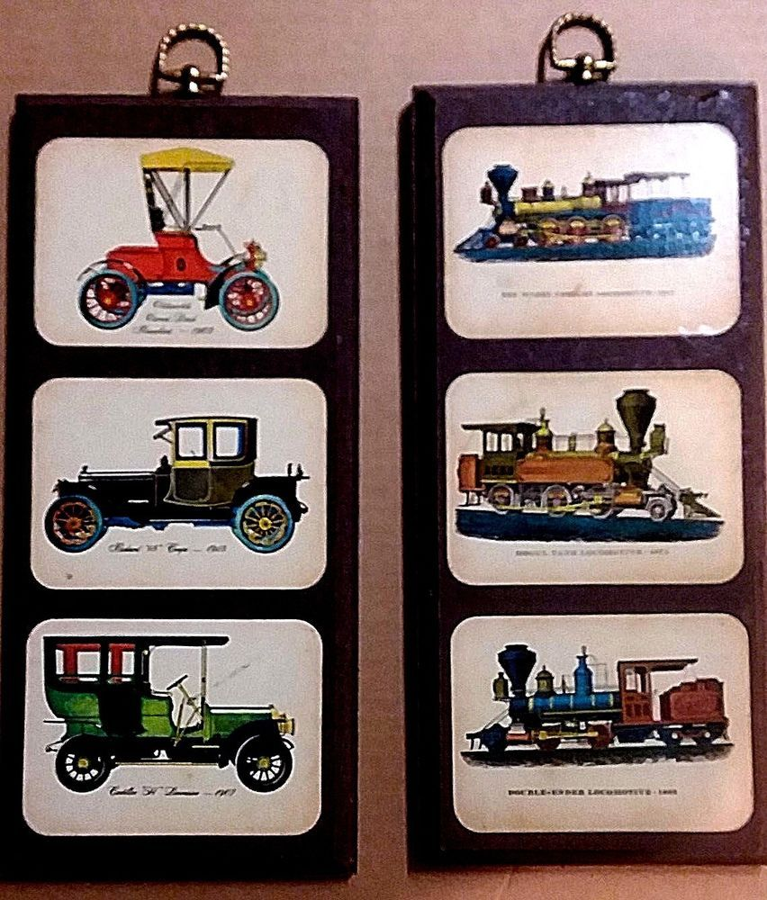 Two vintage wall plaques of trains and cars -title of each listed ...