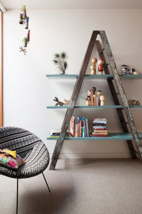 5. The kids' rooms need not be neglected in a rental. Get creative with storage and display cases. Here, a re-purposed...