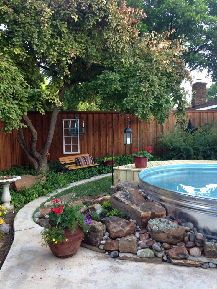 Incredible Stock Tank Pool Ideas With Deck Installation For Summer