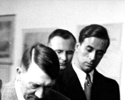 1936, with Karl Brandt looking on. Wonderful hair here. (via ...
