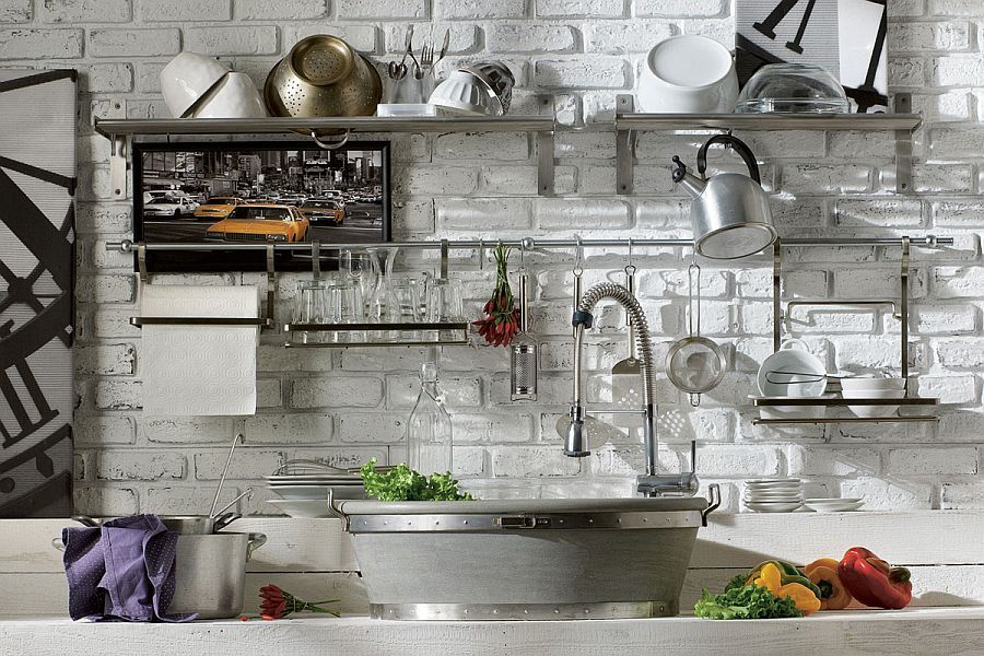 Open stainless steel shelves set against brick wall in the kitchen ...