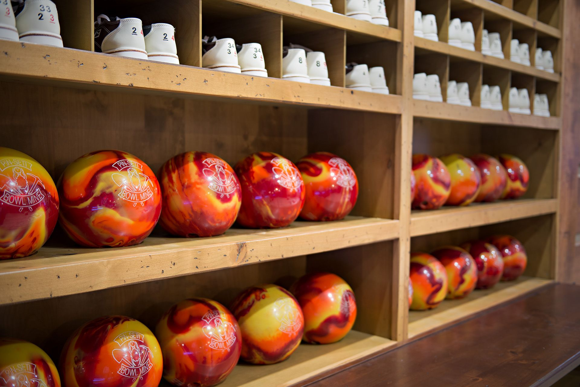 Builtin storage for guest bowling balls and shoes in home