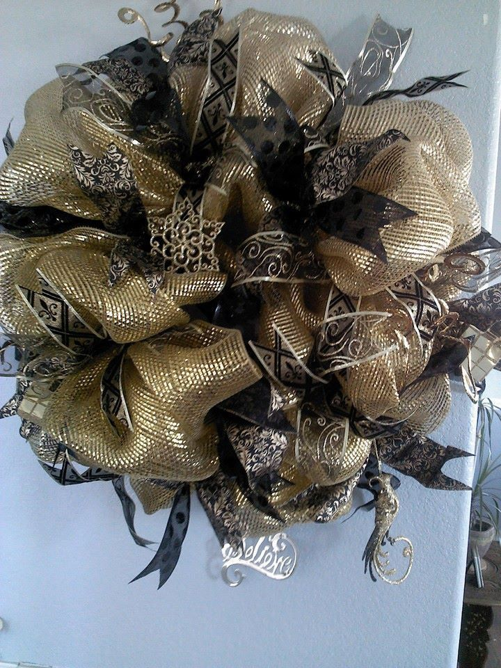 Black And Gold Holiday Wreath by WreathsbyBnE on Etsy, $75.00