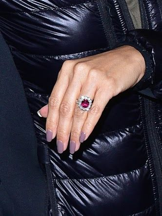 Ruby Engagement Ring - Eva Longoria's ring. I'd prefer a rectangular shaped centre stone, and a smaller halo of diamonds but the colour of this ring is gorgeous.
