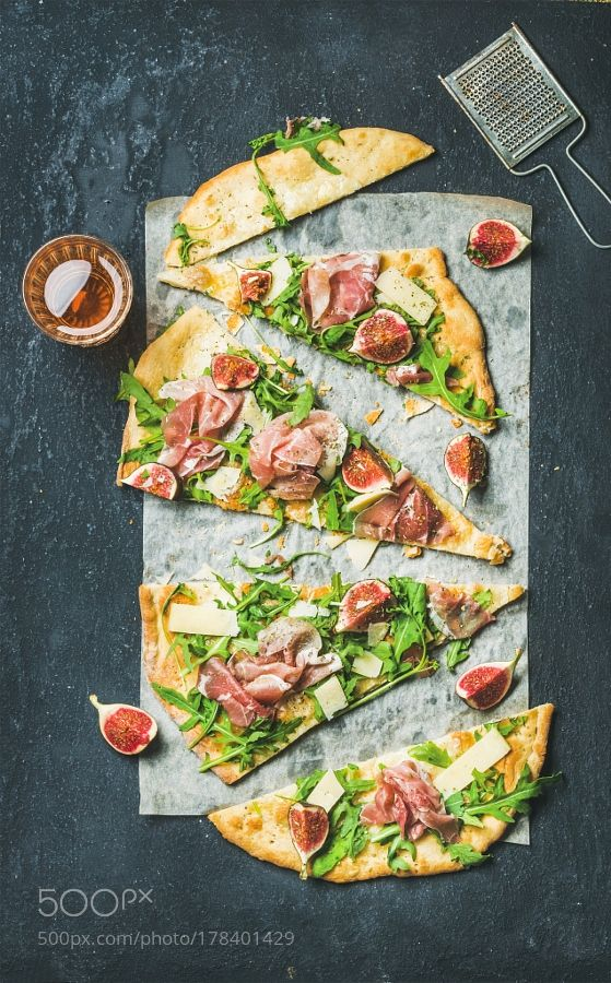 Fig prosciutto arugula and sage flatbread pizza cut into pieces by 2enroute #food #yummy #foodie #delicious #photooftheday #amazing #picoftheday