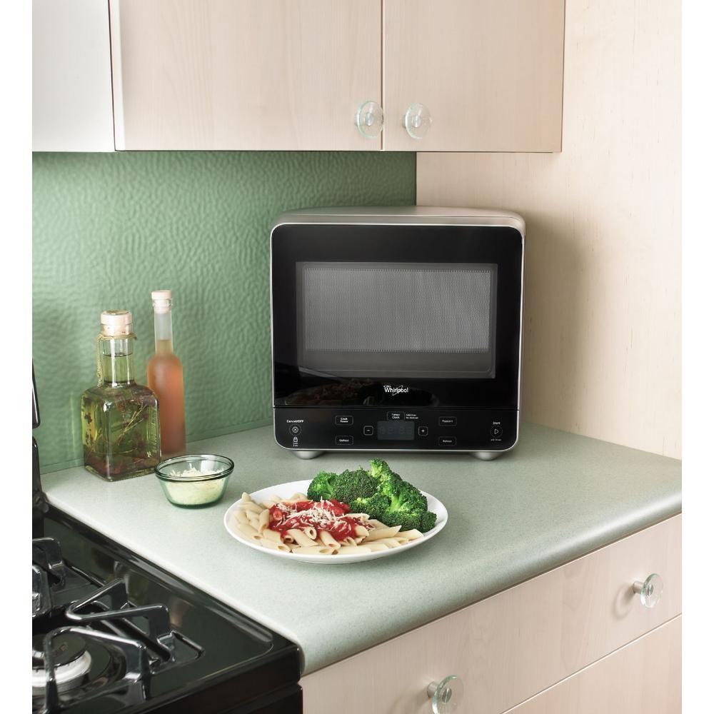 Whirlpool 0 5 Cu Ft Countertop Microwave In Black