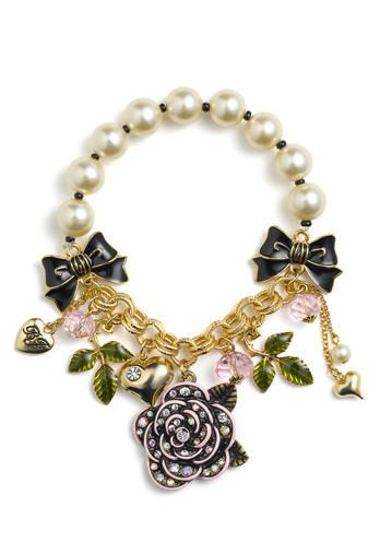 Image from http://www.ma-petite-chou.com/wp-content/uploads/2010/12/Betsey-Johnson-Betseys-Dollhouse-Rose-Charm-Stretch-Bracelet.jpg.