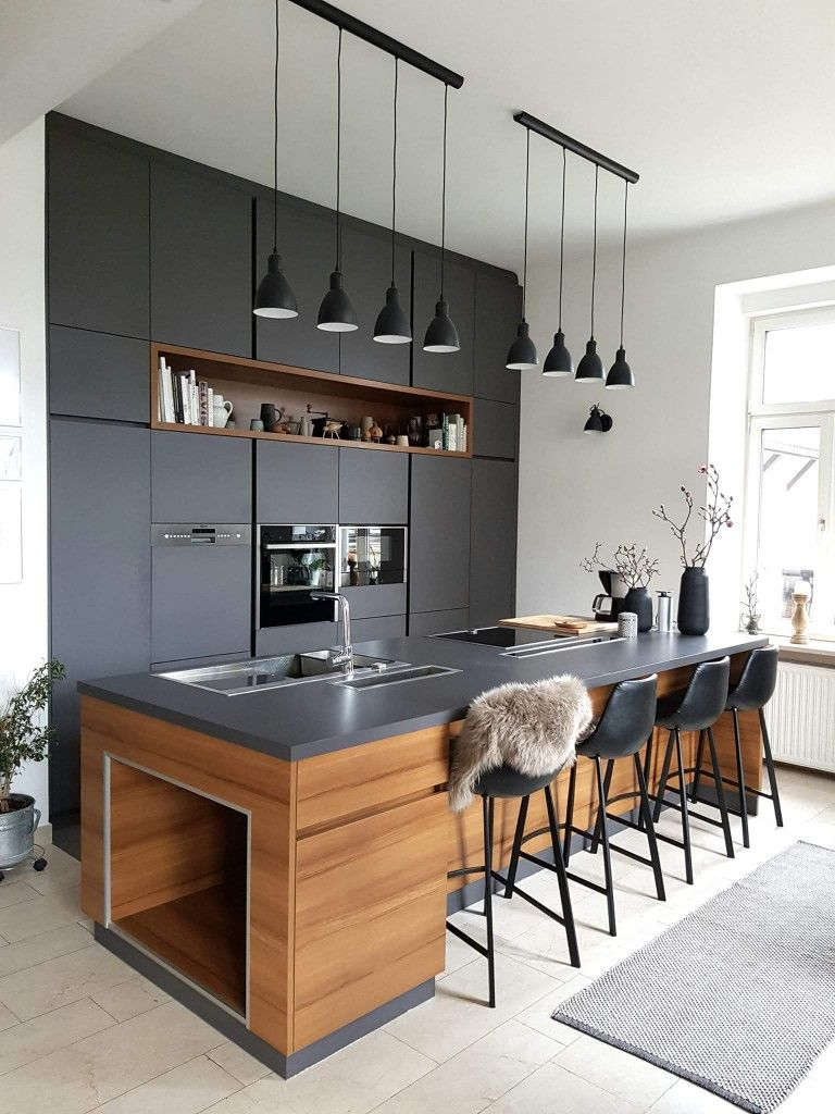 The Look Of Dark Gray Countertop With Walnut Cabinets In