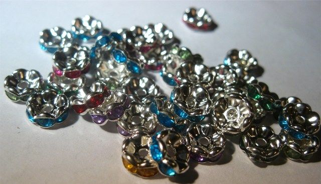 '40 Rhinestone Rondelle Spacers Size 8MM' is going up for auction at 11pm Sat, Feb 16 with a starting bid of $5.