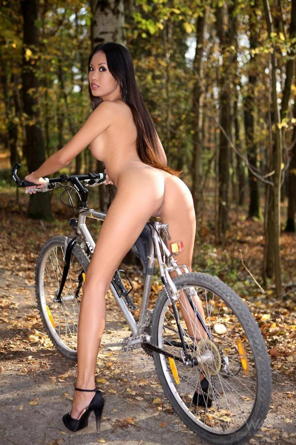 Naked Girl On A Bike