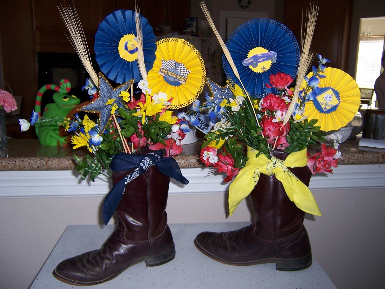 Blue and gold banquet centerpieces using his boots as