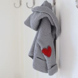 Knit heart elbow patches for your child's sweater for instant cuteness!  Free knit heart pattern.